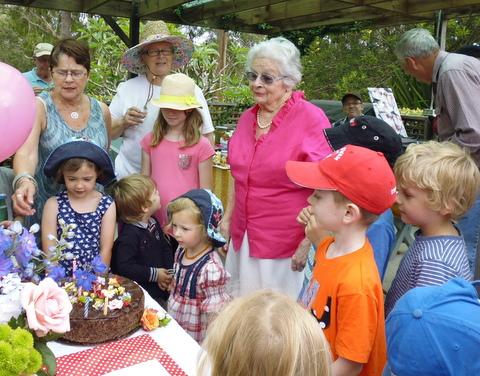 Pat admiring cake her birthday cake