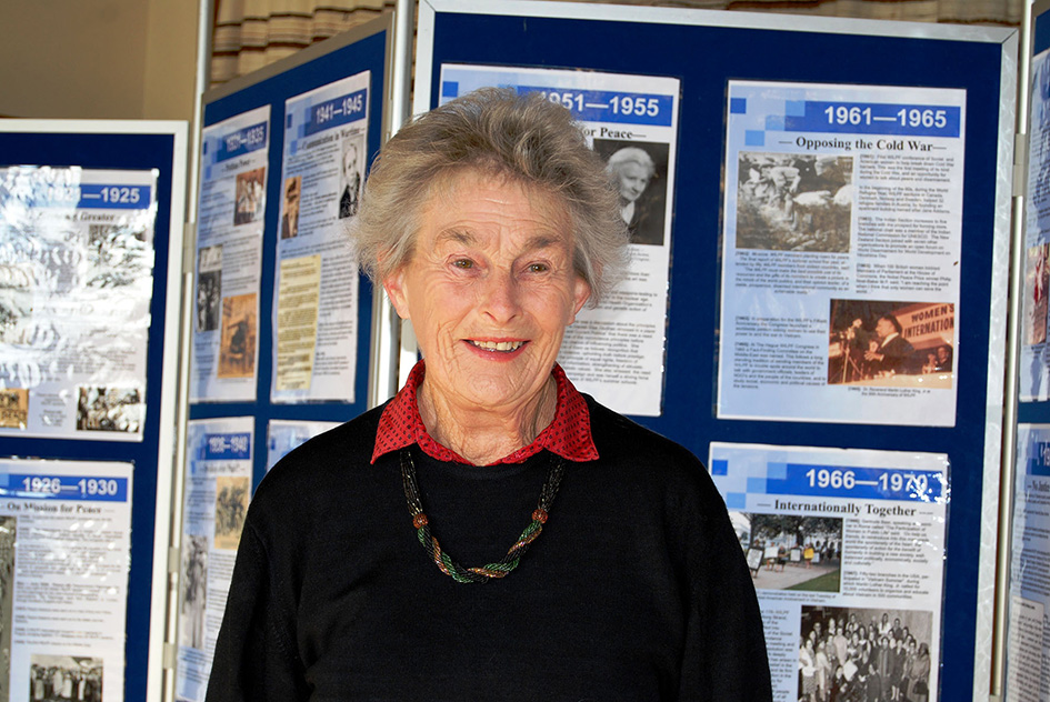 Joan with WILPF display